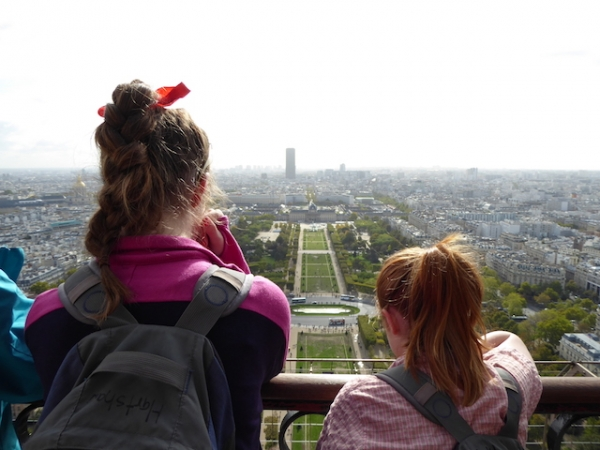 Photo of Paris taken from la tour Eiffel, including myself and my sister.